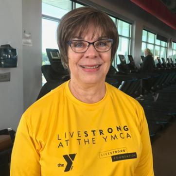 female graduate smiling after graduating LIVESTRONG at the YMCA