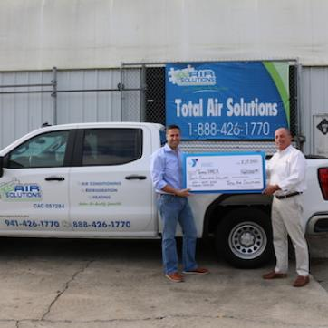 Total Air Solutions presents check to Tampa YMCA.