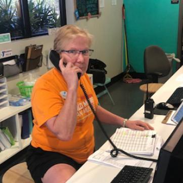 YMCA staff member on the phone at welcome center