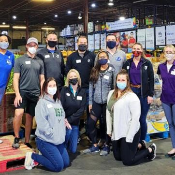 group of tampa ymca staff wearing masks while volunteering